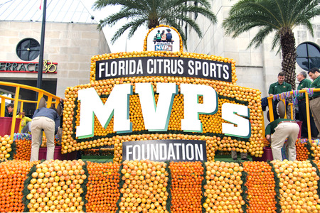 florida citrus: ORLANDO FL - December 30, 2013 -  Allegorical wagon at Florida Citrus Parade in Orlando Florida