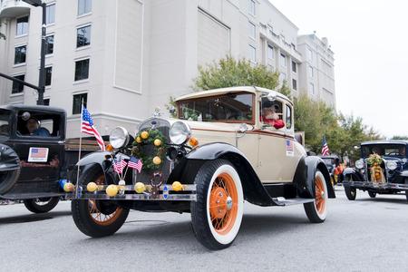 florida citrus: ORLANDO FL - December 30, 2013 -  Vintage car at Florida Citrus Parade in Orlando Florida Editorial