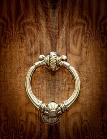 Vintage knocker on decorated background photo