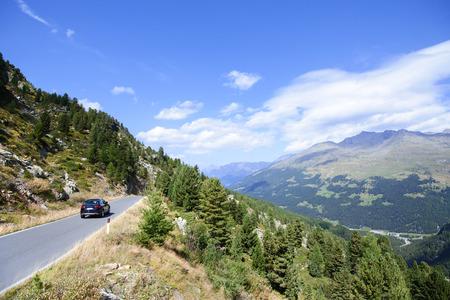 gavia: Car traveling in Gavia Pass, Lombardy Italy. Stock Photo
