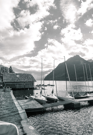 sepia toned: Grundlesee Austria, Boats to the pier on sepia toned.
