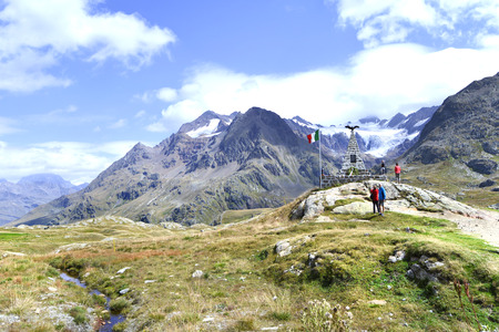 gavia: Tourists at the Monument of the fallen in Passo Gavia, dolomites mountain, Italy