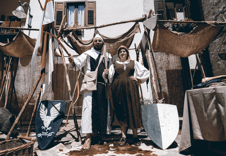 tormented: CALDES, ITALY - JULY 16-17, 2016. Portrait of archers in medieval costumes During The event Amor Cortese, evocation of a tormented love between Olinda and Arunte in Caldes, Trentino Alto Adige, Italy. Editorial