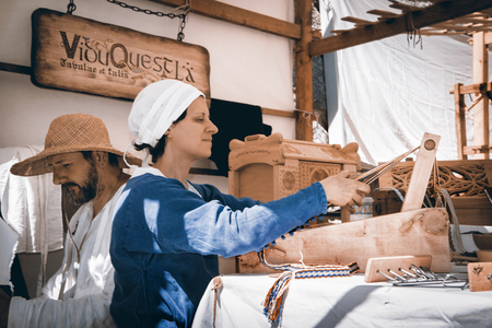 artisans: CALDES, ITAL- JULY 16-17, 2016. Portrait of artisans in medieval costumes During The event Amor Cortese, evocation of a tormented love between Olinda and Arunte in Caldes, Trentino Alto Adige, Italy.