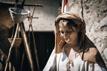 tormented: CALDES, ITALY - JULY 16,17- 2016. Portrait of woman in medieval costumes During The event Amor Cortese, evocation of a tormented love between Olinda and Arunte in Caldes, Trentino Alto Adige, Italy.