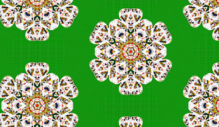 Queen cards in a flower shape on a green table, kaleidoscope effect.