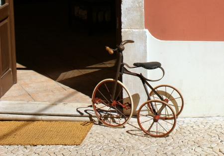 antique tricycle: An old child tricycle