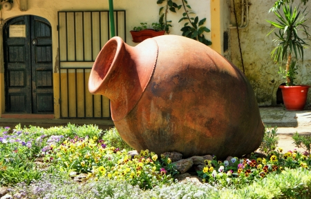 Garden decoration with amphora in Moura, Portugal  photo