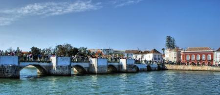 Ancient bridge in Tavira city, Portugal Stock Photo