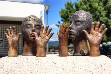 Public sculpture of hands and heads in Vila Nova de Cerveira Stock Photo - 21986243