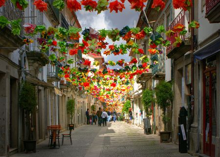 Old street decorated with flowers in Viana do Castelo, Portugal