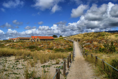 Boardwalk through the sand dunes on beach in Portugal Stock Photo - 49584802