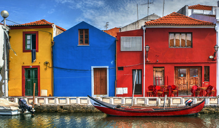 Colorful houses and typical boats in Aveiro, Portugal Stock Photo - 78250620