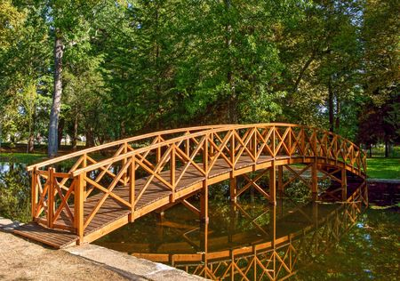 Bridge over garden lake in Vidago, Portugal Banco de Imagens - 84976679