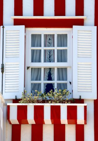 Window of striped houses in Costa nova, Aveiro, Portugal