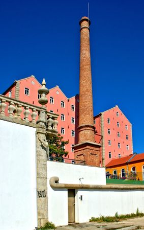 Old factory and chimney in Porto, Portugal Banco de Imagens