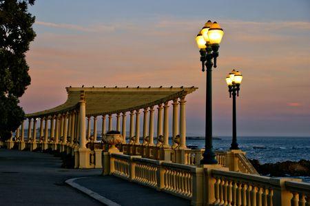 Coastal way sunset with Pergola at Foz do Douro, Oporto, Portugal Banco de Imagens