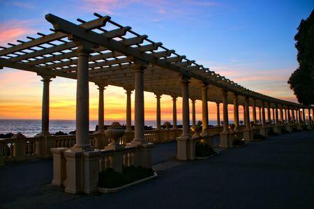 Coastal way sunset with Pergola at Foz do Douro, Oporto, Portugal Banco de Imagens - 122108741