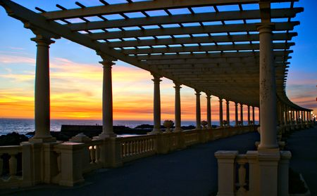 Coastal way sunset with Pergola at Foz do Douro, Oporto, Portugal Banco de Imagens