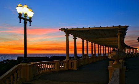 Coastal way sunset with Pergola at Foz do Douro, Oporto, Portugal Banco de Imagens - 122108746