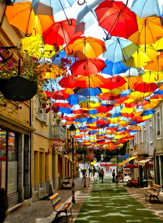 Colorful umbrellas over street in Agueda, Portugal Banco de Imagens - 122108723