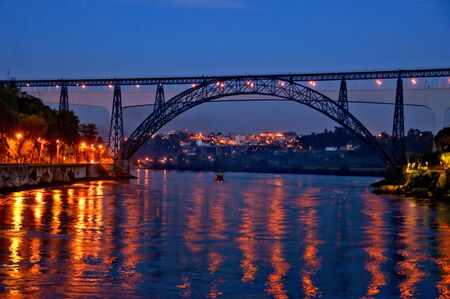 Ancient iron old train bridge in Oporto, Portugal Banco de Imagens