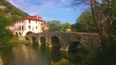 Bridge of the Trinity (Villava) in French Way of Santiago, Pamplona Banco de Imagens - 128074799