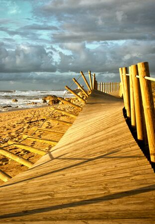 Beach walkways after storm in Portugal Banco de Imagens - 128074886