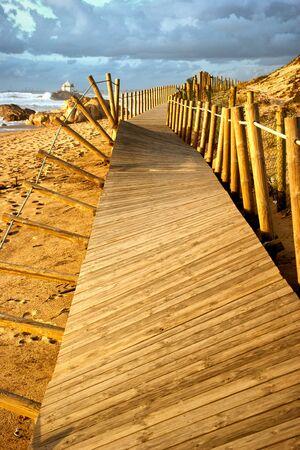 Beach walkways after storm in Portugal Banco de Imagens - 128074891