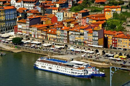 Panoramic view of Douro river and rooftops of Porto, Portugal Banco de Imagens - 128074931