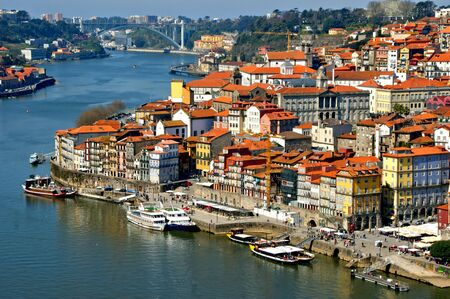 Panoramic view of Douro river and rooftops of Porto, Portugal Banco de Imagens - 128074928