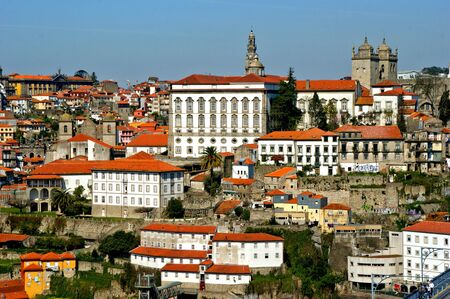 Panoramic view of Douro river and rooftops of Porto, Portugal Banco de Imagens - 128074932