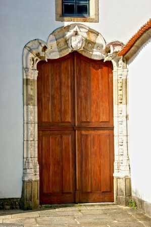 Old decorated door in Vila do Conde, Portugal Stock Photo