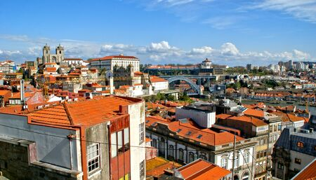 Panoramic view of Douro river and rooftops of Porto, Portugal