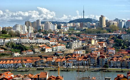 Panoramic view of Douro river and rooftops of Porto, Portugal Banco de Imagens - 128074964