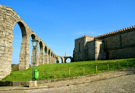 Old aqueduct & Santa Clara's Monastery in Vila do Conde, Portugal Stock Photo - 128074969