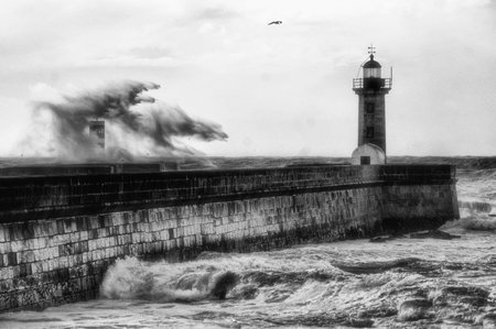 Storm in Oporto lighthouse, Portugal Banco de Imagens - 128079597