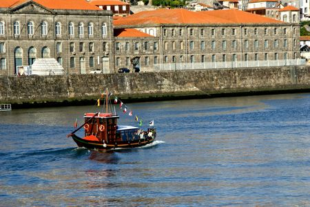 Tourist boat on Douro river overlooking Porto, Portugal Stock Photo - 132892342