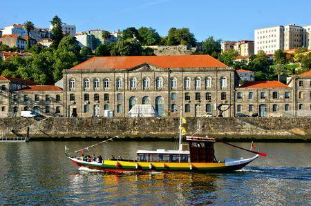 Tourist boat on Douro river overlooking Porto, Portugal Stock Photo - 132892346