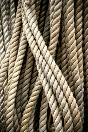 Coiled craft navy rope in seaport Stock Photo - 138722058