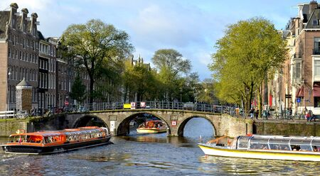 Amsterdam canal and boats in the Netherlands