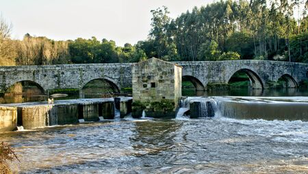 Traditional watermills on the Ave river, Portugal   Stock Photo