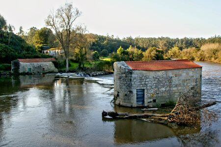 Traditional watermills on the Ave river, Portugal   Banco de Imagens