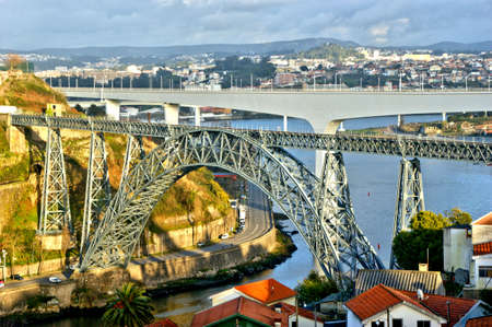 Old and new railway bridges over Douro river in Oporto, Portugal
