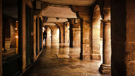 Under the arcades on a street in Santiago de Compostela, Spain