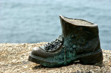 Pilgrim boot sculpture in Cape Finisterre, Spain Editorial