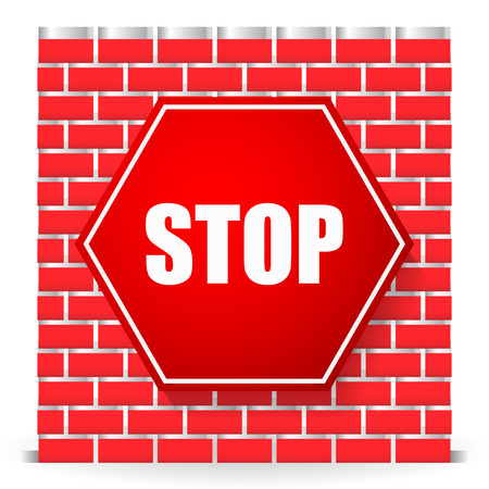 restricted area sign: Stop sign on brickwall. Block, blocade, obstruction