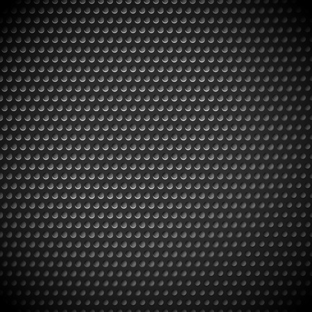 punched: Carbon fiber industrial background with repeatable geometry. Dark, black dotted pattern. Punched, perforated surface. Abstract texture.