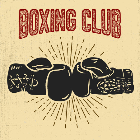 Boxing gloves on grunge background.