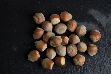 Hazelnut nut isolated on black stone background